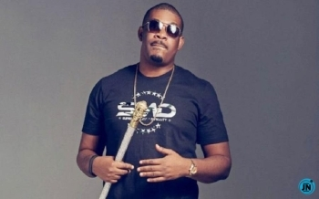 Don Jazzy Shares Photo of A Dad And Son Moment With His Father